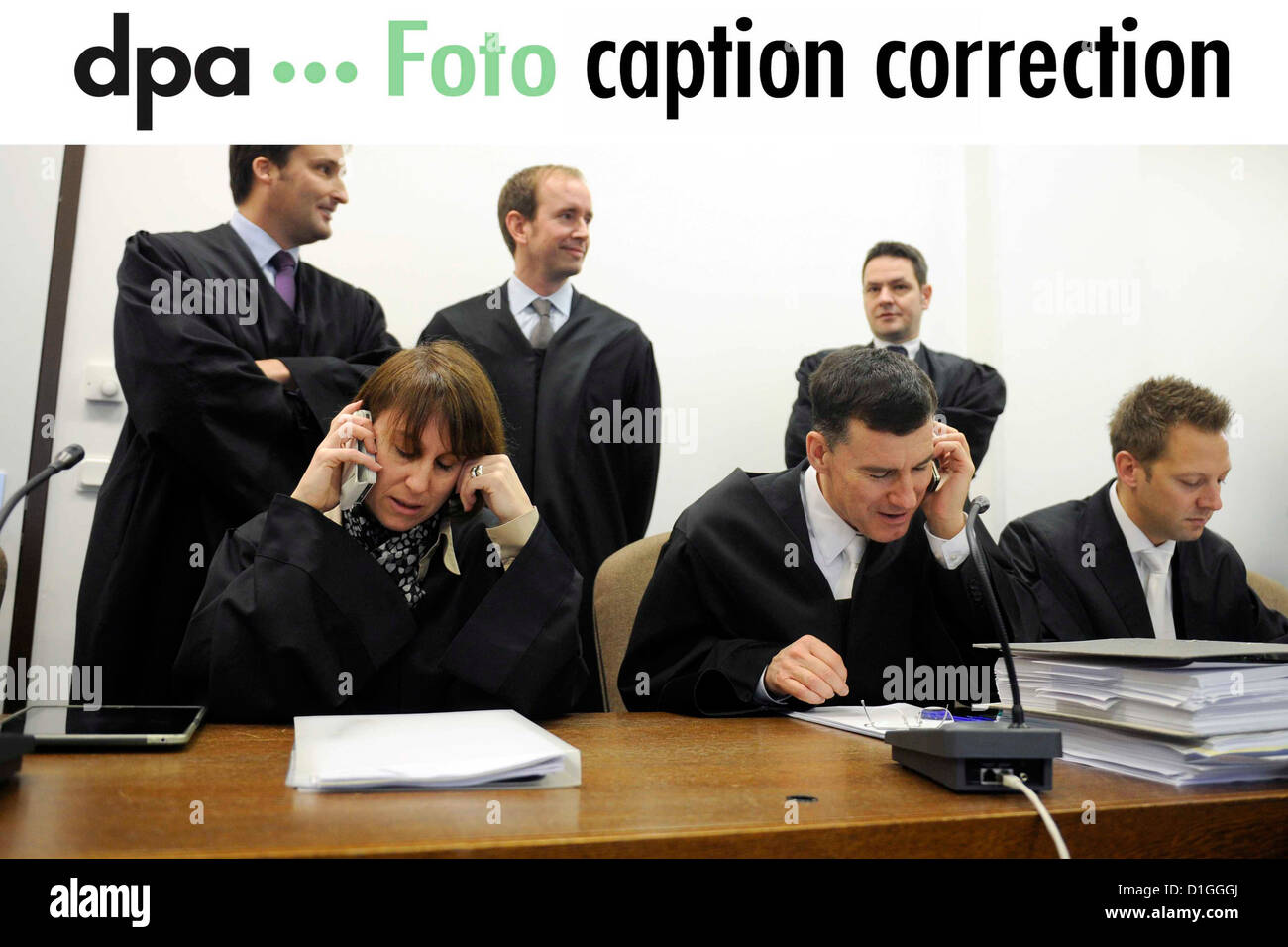 Dear customers, the people in this picture sent on 18 December 2012 have been wrongly identified. They are representatives - Stock Image