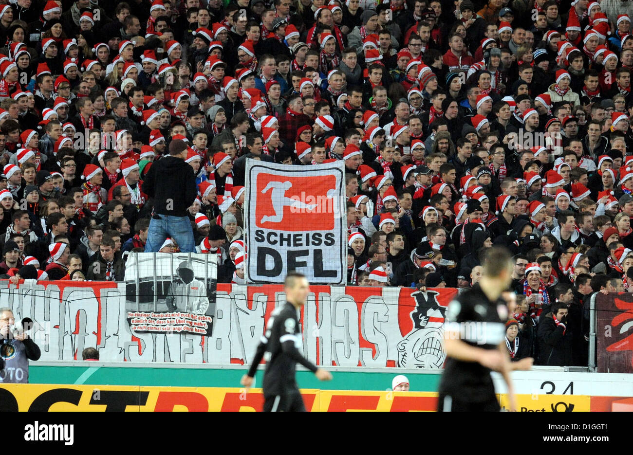 VfB Stuttgart fans cheer during the DFB Cup soccer match between VfB Stuttgart and 1st FC Koeln at the Mercedes - Stock Image