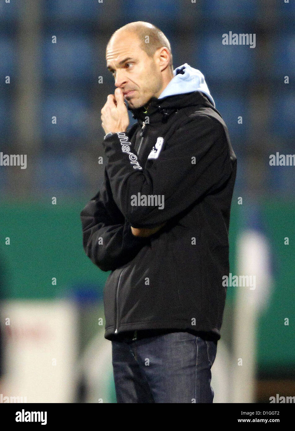 Munich's head coach Alexander Schmidt grabs his nose during the DFB Cup round of sixteen match between VfL Bochum - Stock Image