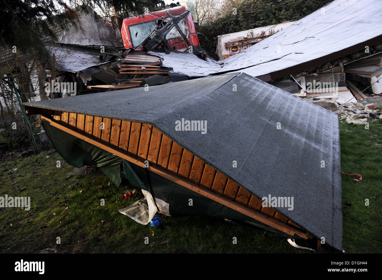 A derailed fright train is seen behind debris in Duesseldorf, Germany, 20 December 2012. On 19 December 2012, two - Stock Image