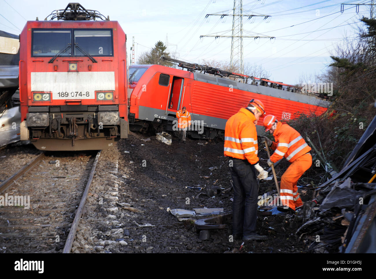 Workers stand in front of a derailed fright train in Duesseldorf, Germany, 20 December 2012. On 19 December 2012, - Stock Image