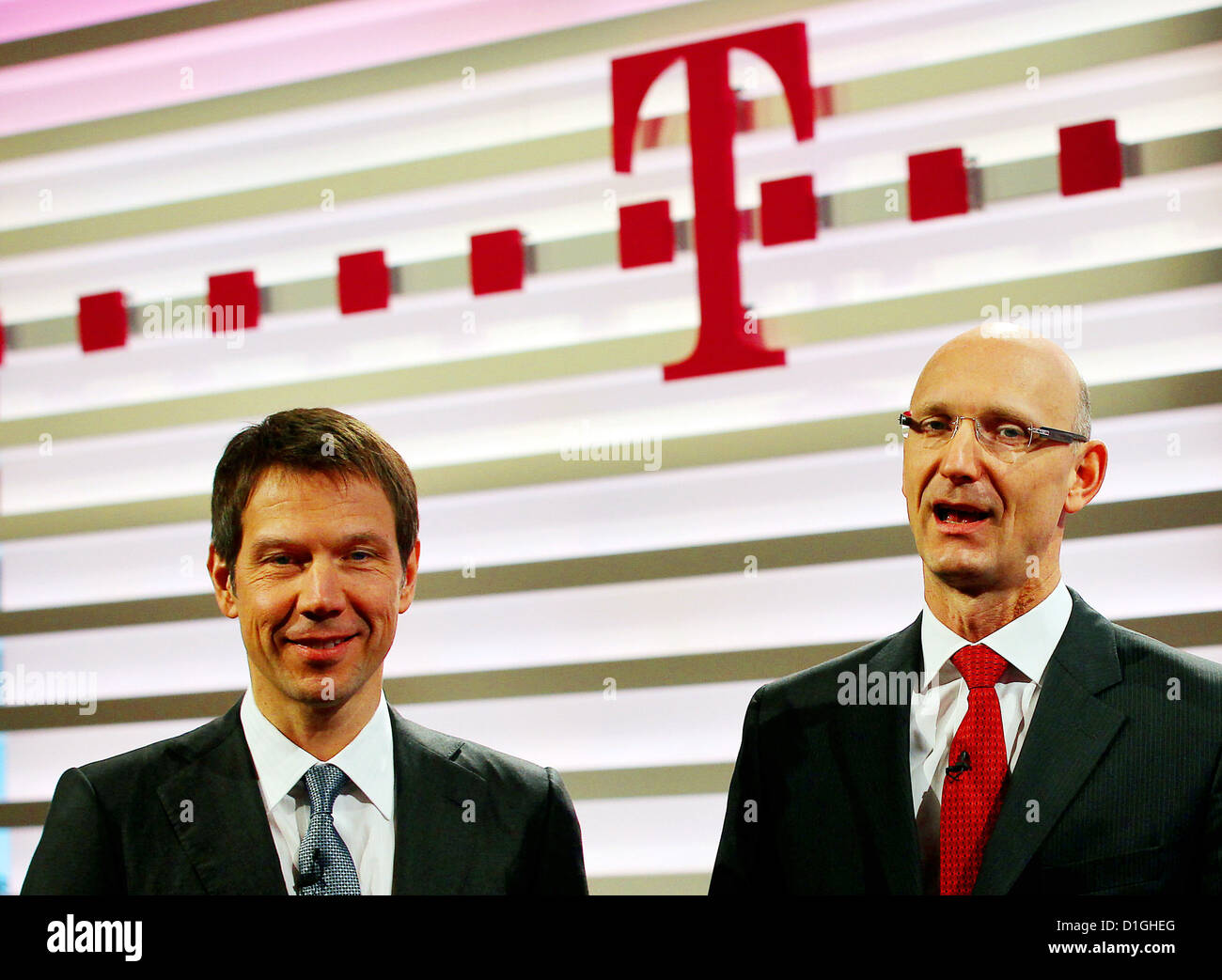 Deutsche Telekom CEO Rene Obermann (L) and CFO Timotheus Hoettges (R) arrive for the telecommunication group's balance Stock Photo