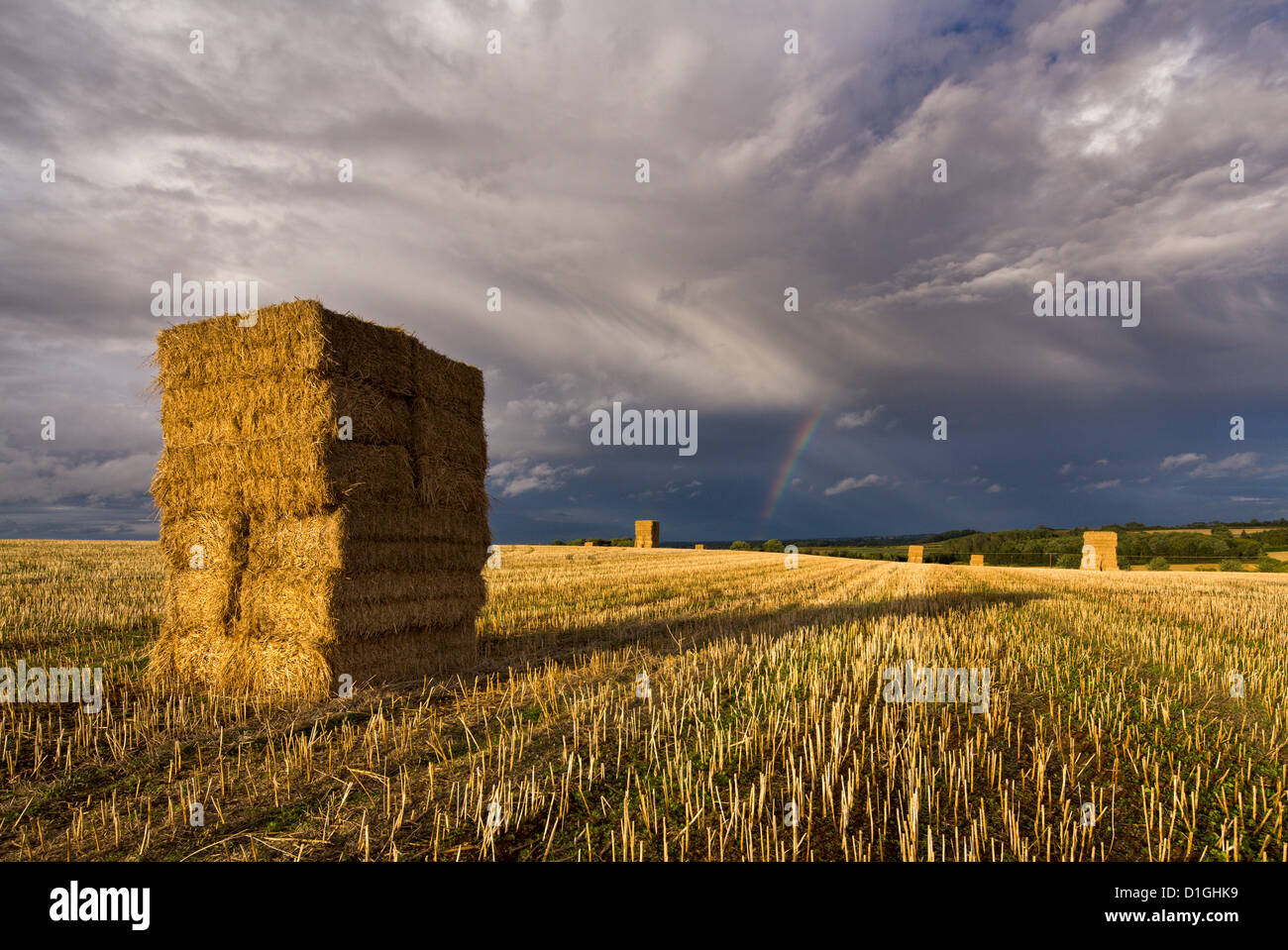 Rainbow and stormy clouds over hay bales, Bramham, West Yorkshire, Yorkshire, England, United Kingdom, Europe - Stock Image