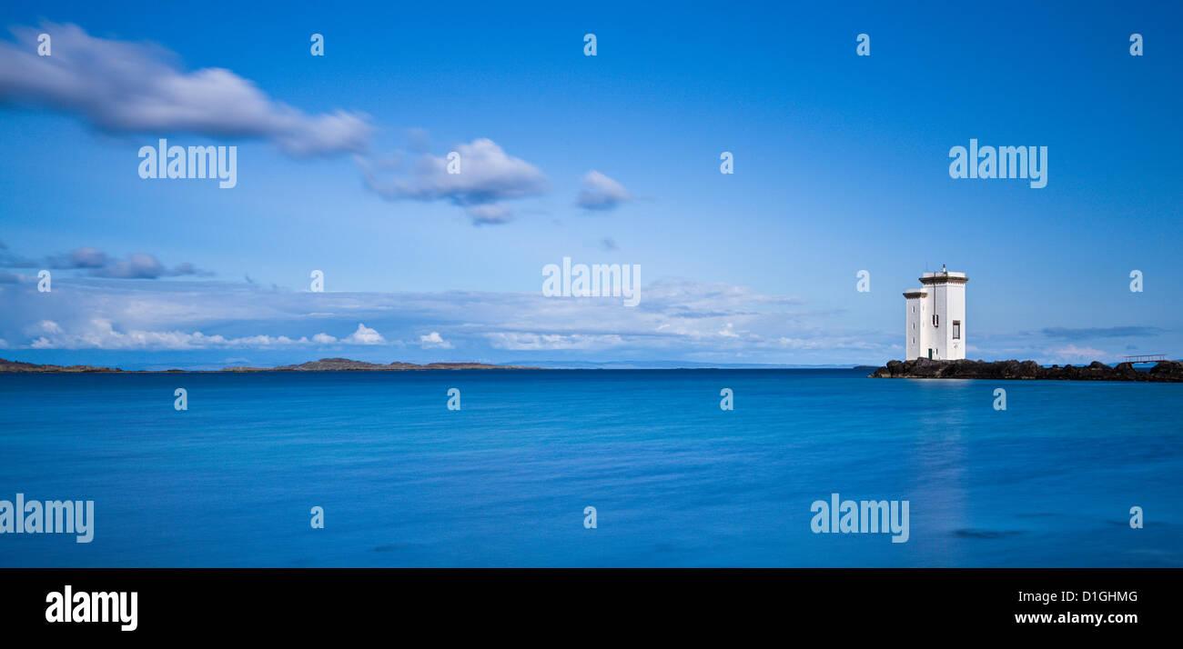 Carraig Fhada lighthouse near Port Ellen on the Isle of Islay, Inner Hebrides, Scotland, United Kingdom, Europe - Stock Image