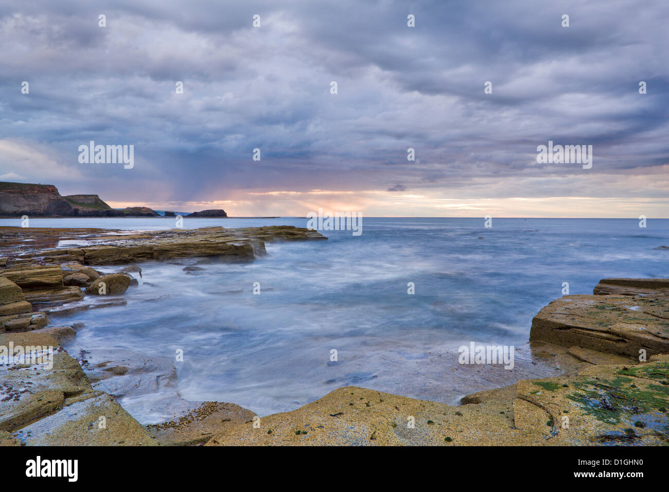 A showery evening at low tide in Saltwick Bay, North Yorkshire, Yorkshire, England, United Kingdom, Europe Stock Photo