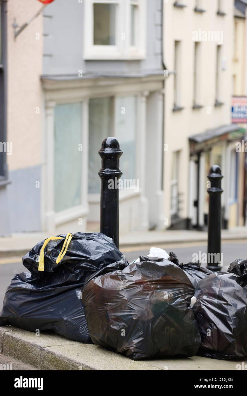 Bin Day rubbish bags waste - Stock Image