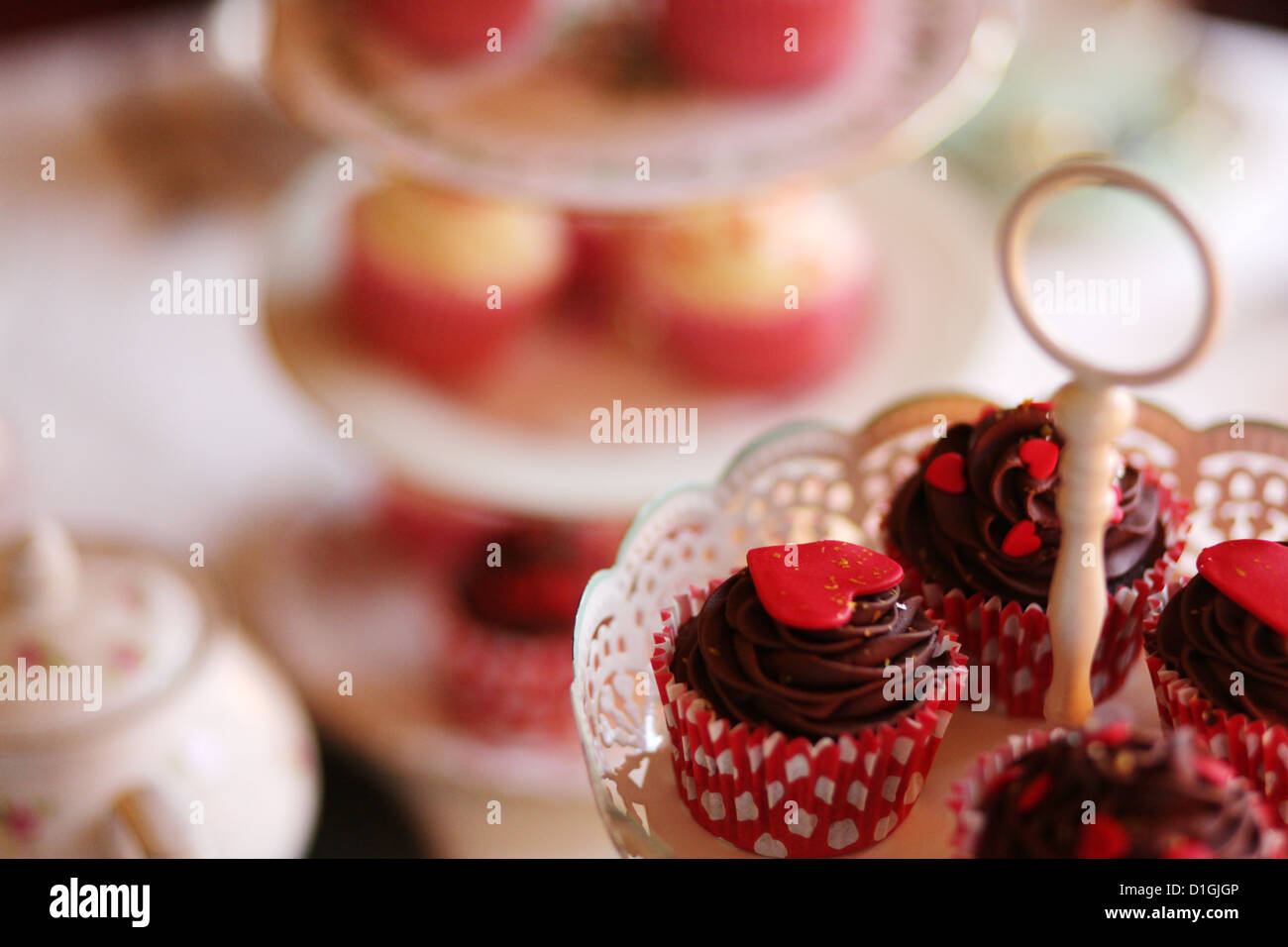 Tea party with cupcakes and tea - Stock Image