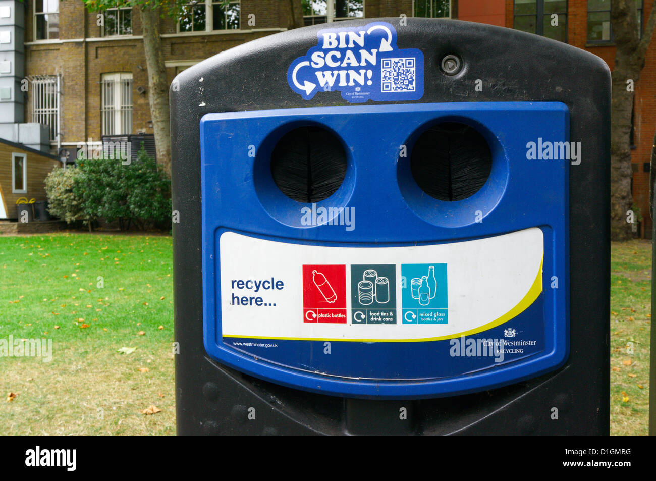 A bottle and can recycling bank with a competition entered by scanning a QR code by mobile 'phone. - Stock Image