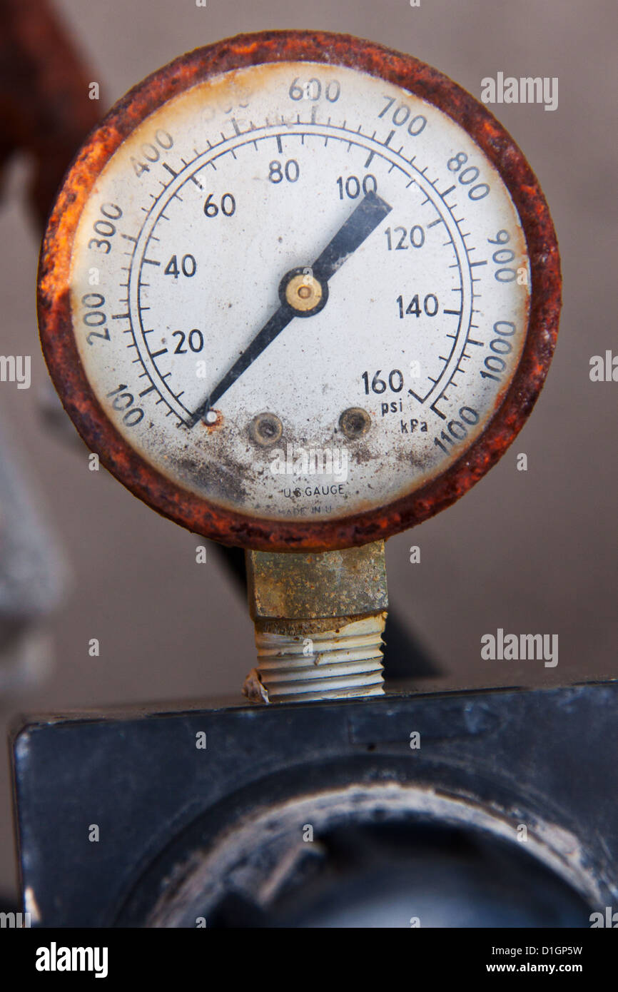 An old and rusty psi gauge with - Stock Image