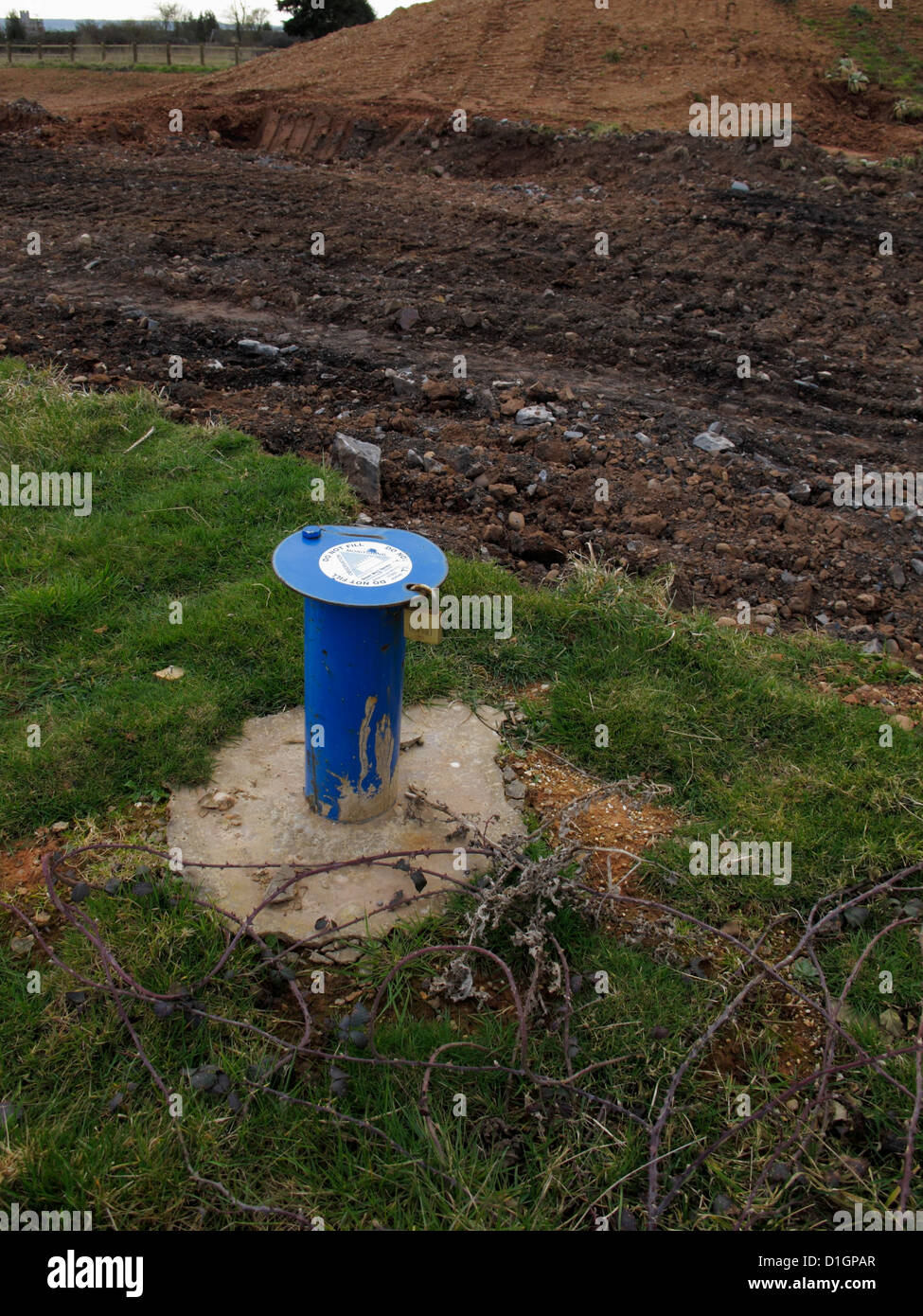 Lockable Cover of borehole standpipe accessed for monitoring groundwater water table level for geotechnical geological - Stock Image