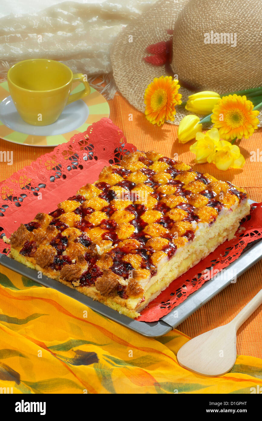 Cake with cream and cherries - Stock Image