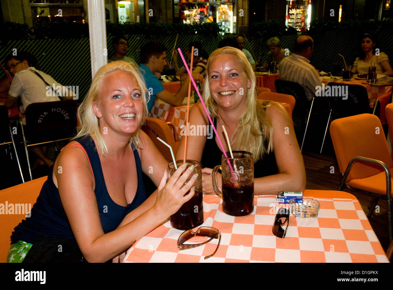 pretty young girls  tourists having a sangria in a Ramblas terrace , Barcelona, Spain - Stock Image
