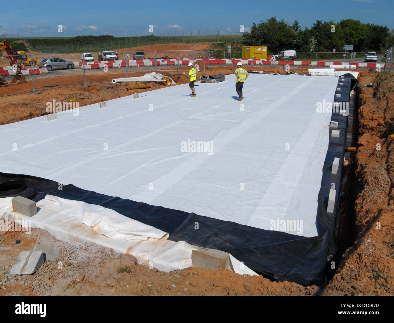 Sustainable drainage stormbloc plastic crate attenuation reservoir system on uk new road construction site - Stock Image