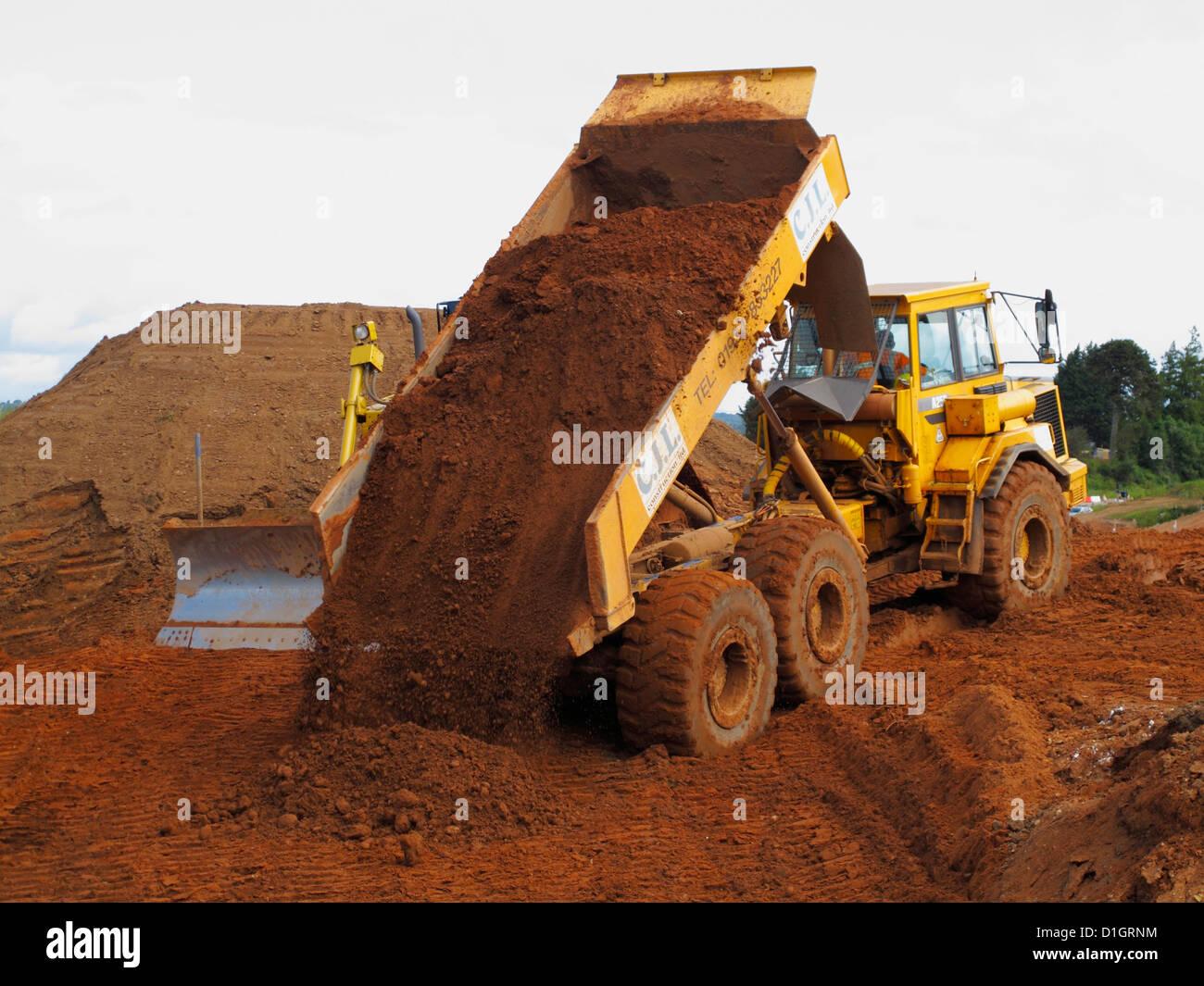 Construction Site Soil : Volvo tipper dump dumper wheeled truck tipping soil on