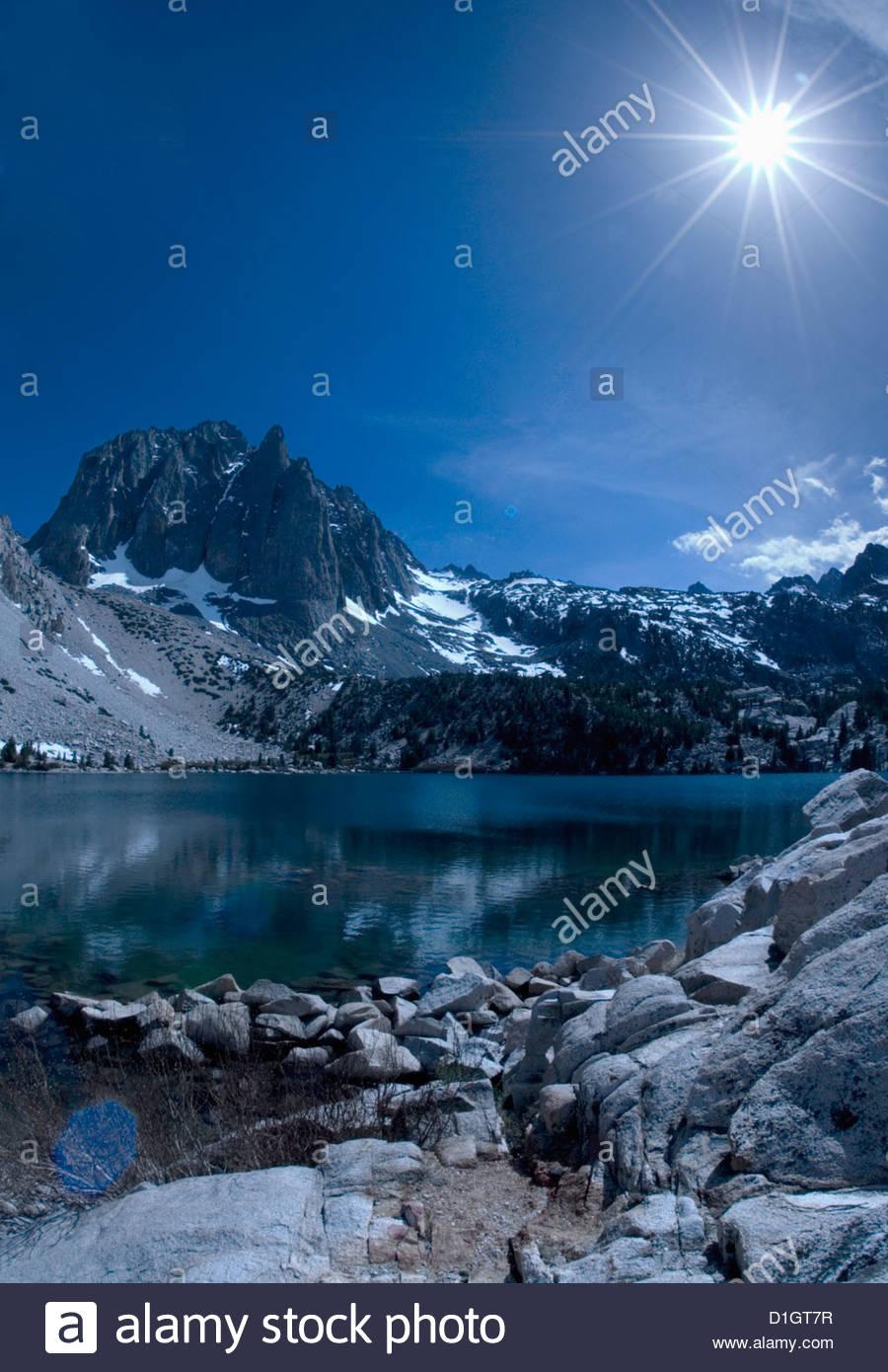 Sun shining over the mountains, Sierra Nevada, California, United States of America, North America - Stock Image