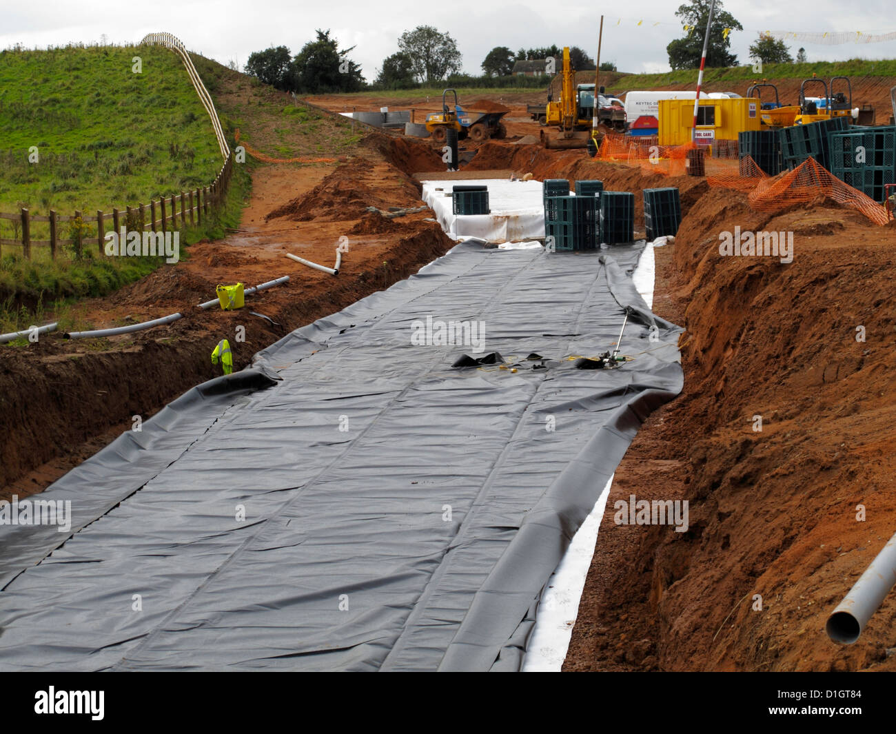 Large underground water storage chamber plastic crate system Sustainable Urban Drainage System SUDS for new highway - Stock Image