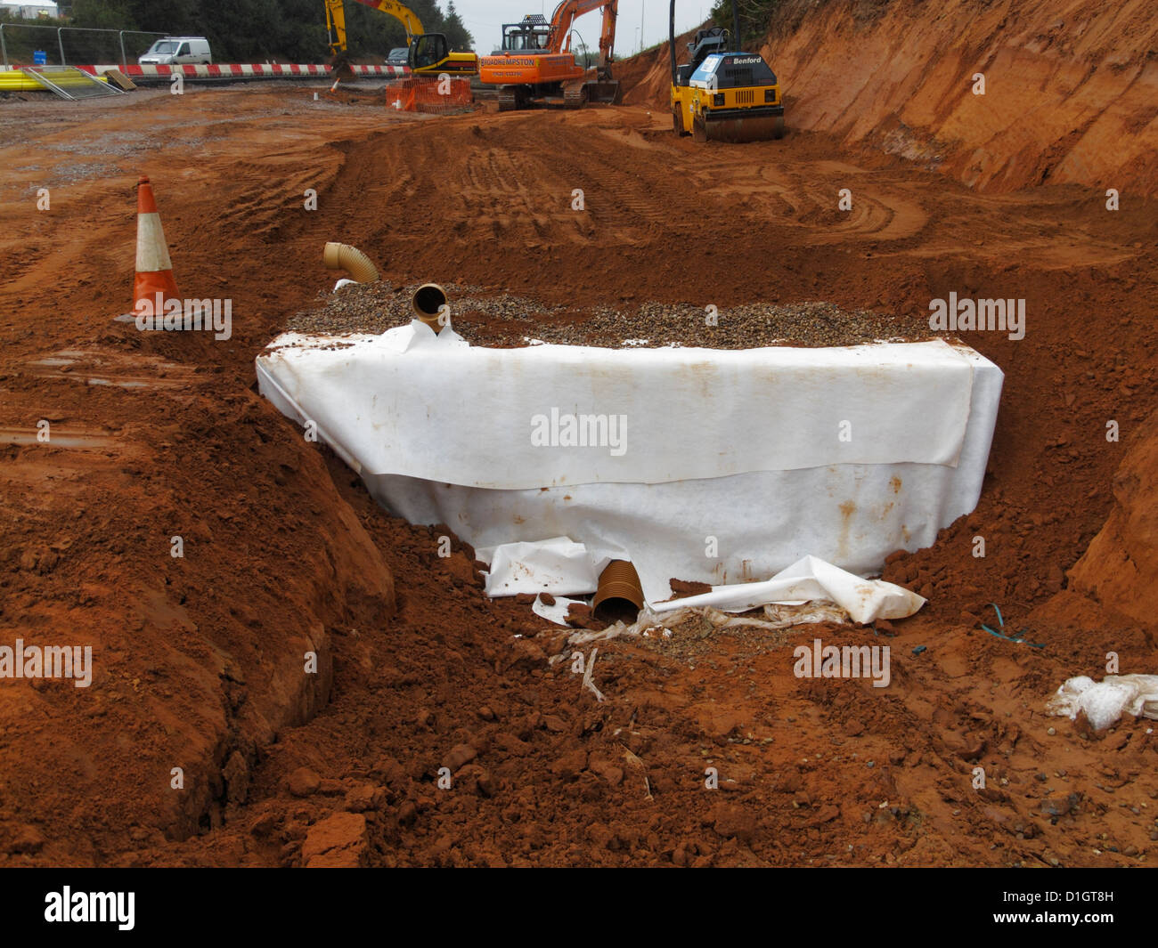 Partly backfilled Sustainable drainage stormbloc plastic crate attenuation reservoir system on uk new road construction - Stock Image