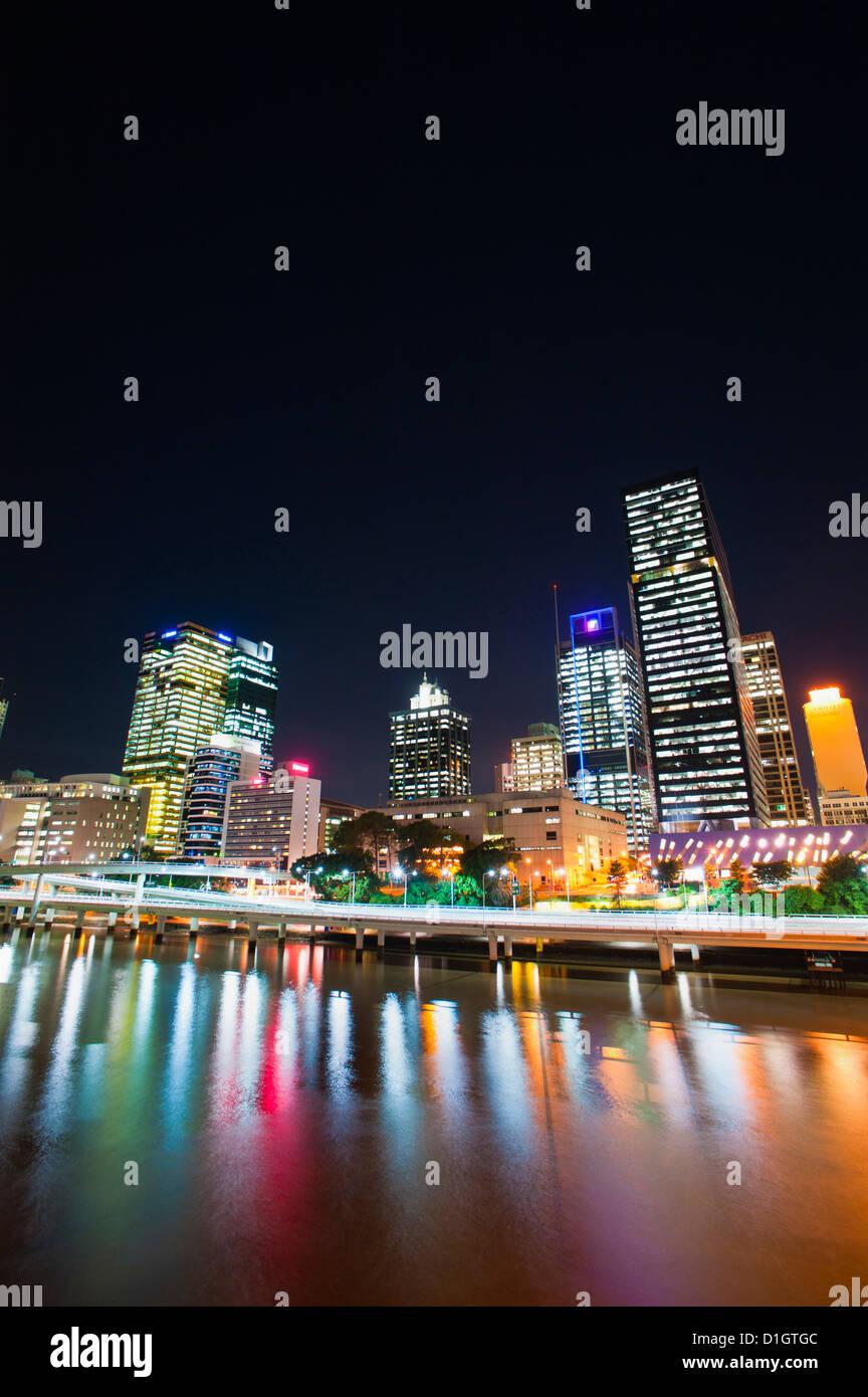 Brisbane skyline at night reflected in Brisbane River, Brisbane, Queensland, Australia, Pacific - Stock Image