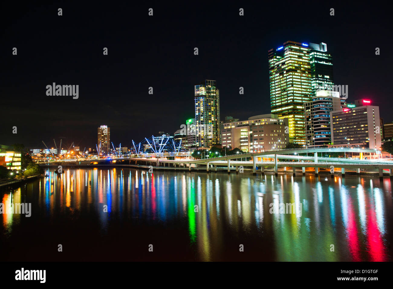 Colourful reflection of city skyline in Brisbane River at night, Brisbane, Queensland, Australia, Pacific - Stock Image