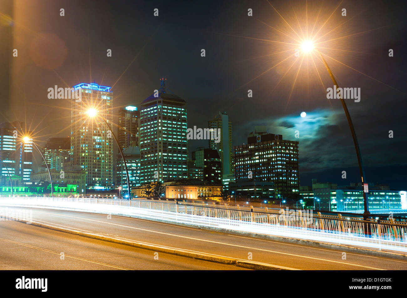 Light trails at night on the bridge from Brisbane city centre to South Bank, Brisbane, Queensland, Australia, Pacific - Stock Image