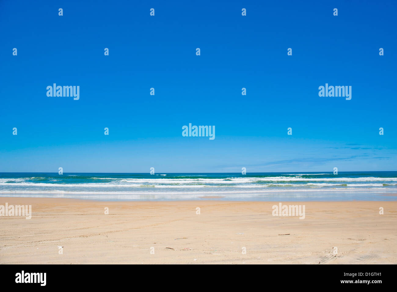 Seventy Five Mile Beach with white sand and blue skies, Fraser Island, Queensland, Australia, Pacific - Stock Image