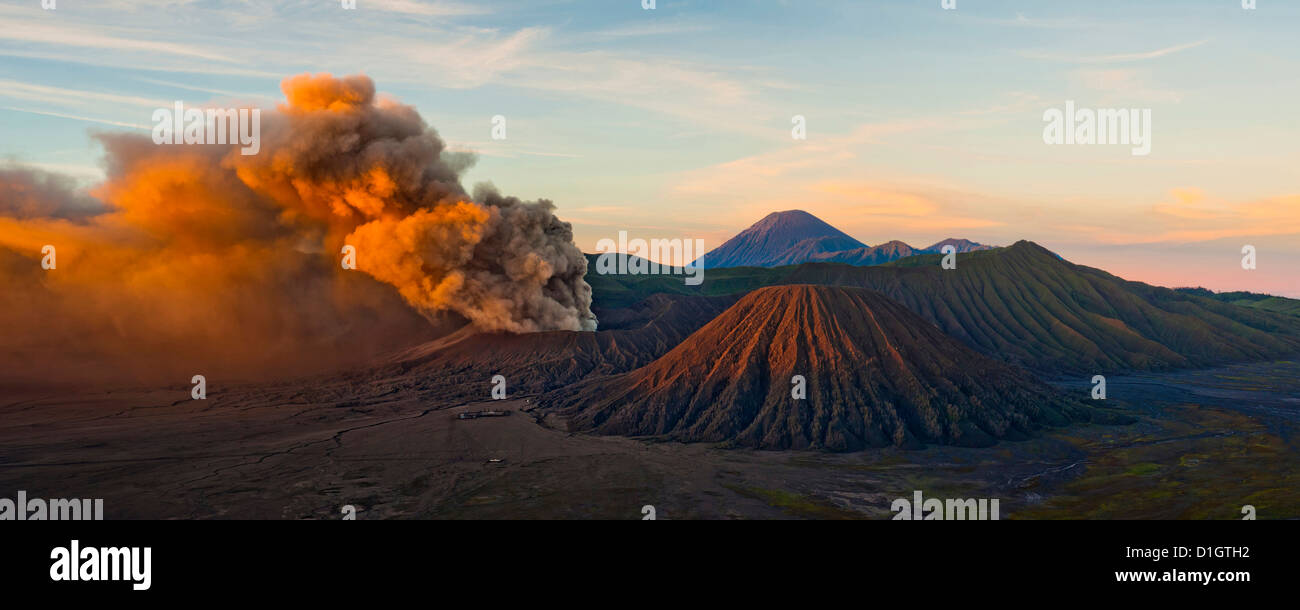 Mount Bromo (Gunung Bromo), an active volcano, erupting at sunrise throwing up ash clouds, East Java, Indonesia, - Stock Image