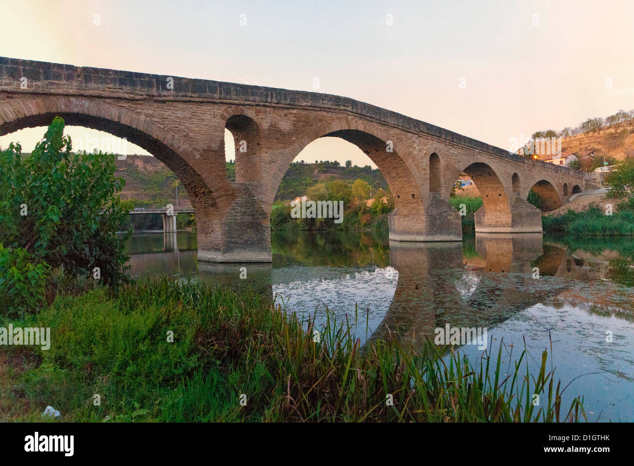 Puente la Reina, a medieval bridge lies between Pamplona and Estella on the Way of St. James pilgrimage route to - Stock Image
