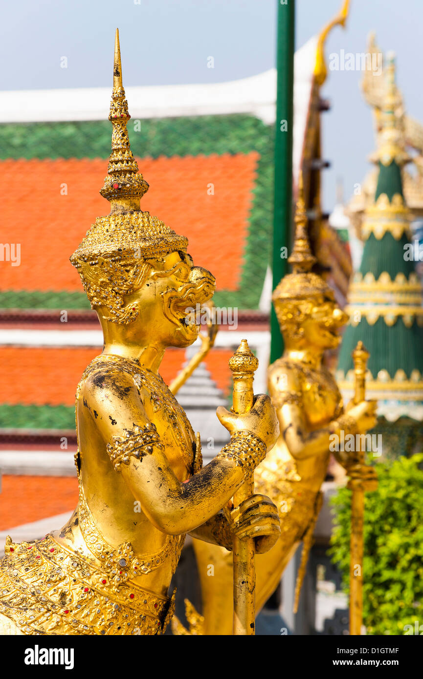 Two gold guardian statues, at the Grand Palace, Bangkok, Thailand, Southeast Asia, Asia - Stock Image