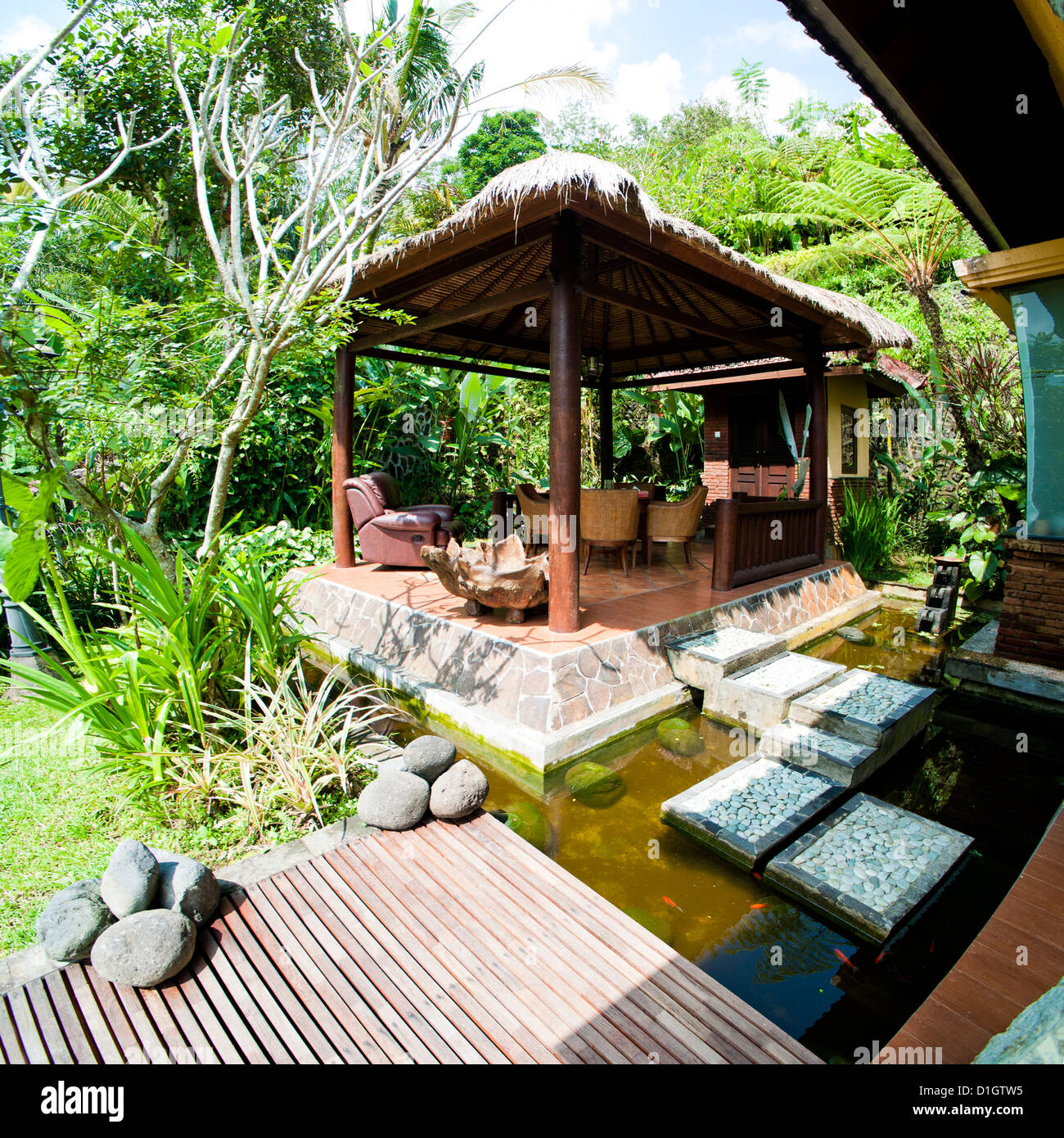 Outdoor area at luxury accommodation near Ubud on the island of Bali, Indonesia, Southeast Asia, Asia - Stock Image