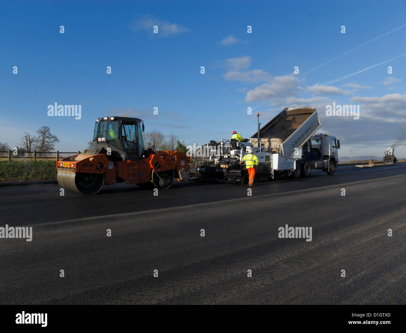 A Civil Engineering contractor highway maintenance gang  laying asphalt road surfacing in UK - Stock Image