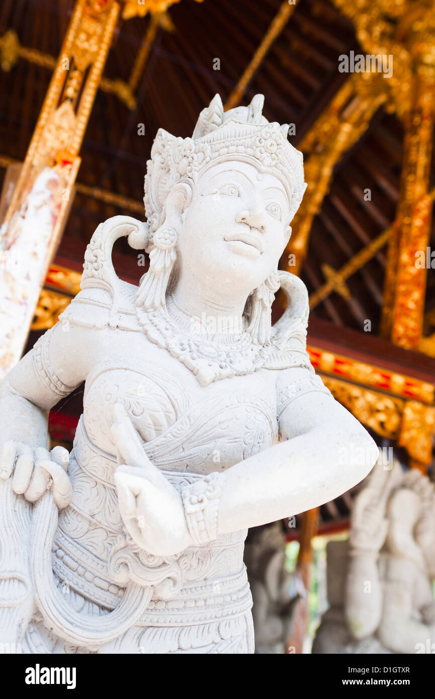 Stone statue, Pura Tirta Empul Hindu Temple, Tampaksiring,  Bali, Indonesia, Southeast Asia, Asia - Stock Image