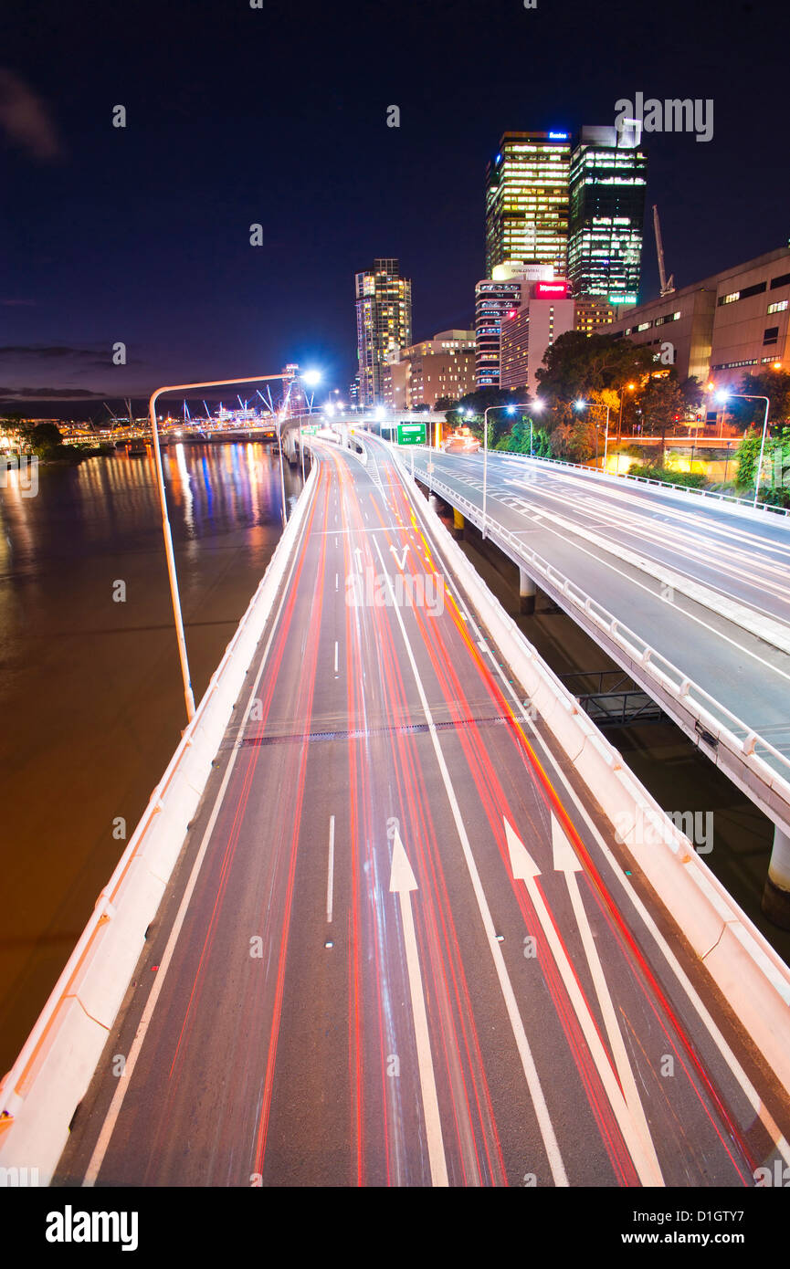 Car light trails at night on a highway in Brisbane, Queensland, Australia, Pacific - Stock Image