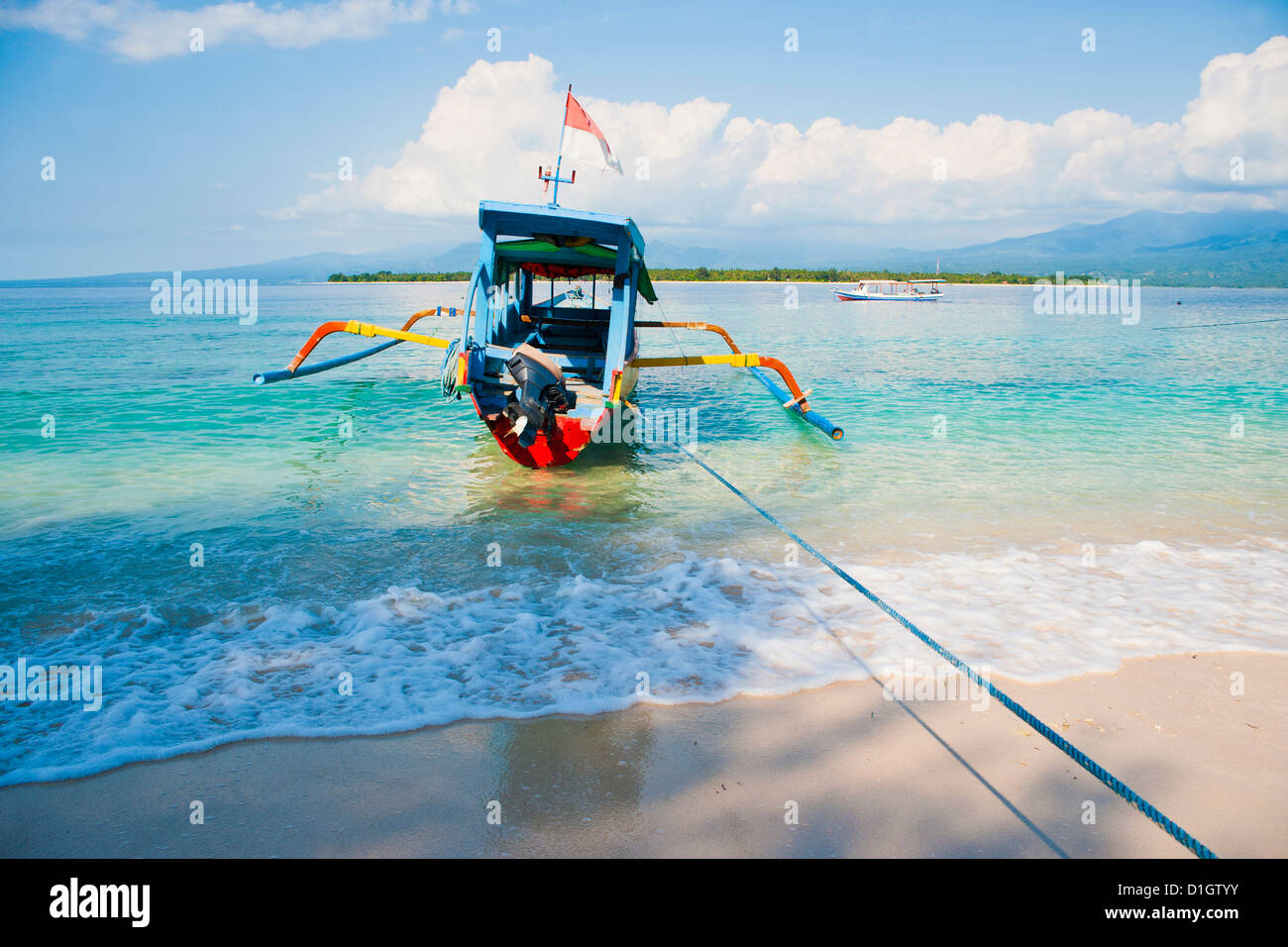Gili Meno, a traditional Indonesian boat on Gili Meno with Gili Air and Lombok in the background, Gili Islands, - Stock Image