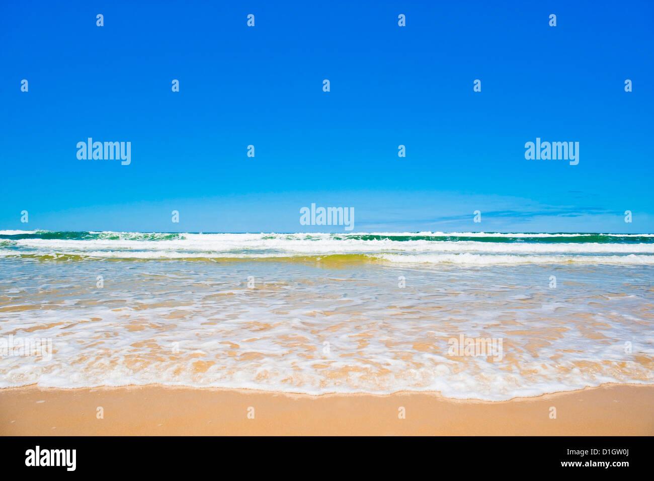 Sand sea and sky of Seventy Five Mile Beach, Fraser Island, UNESCO World Heritage Site, Queensland, Australia, Pacific - Stock Image