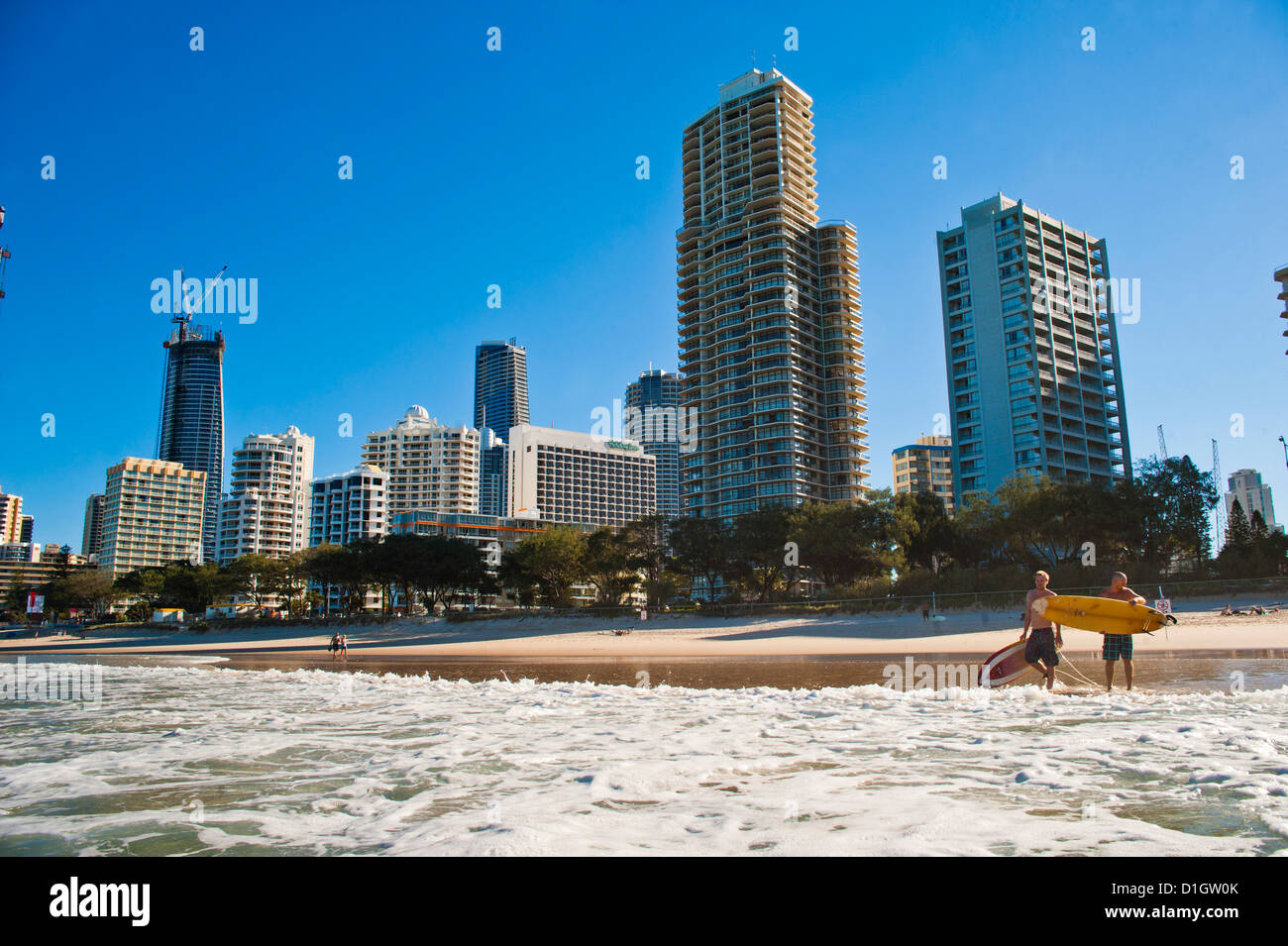 Surfers at Surfers Paradise, Gold Coast, Queensland, Australia, Pacific - Stock Image