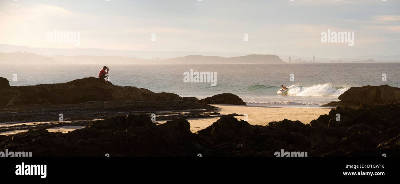 Australian man watching surfers at Tweed Heads, Gold Coast, Queensland, Australia, Pacific - Stock Image