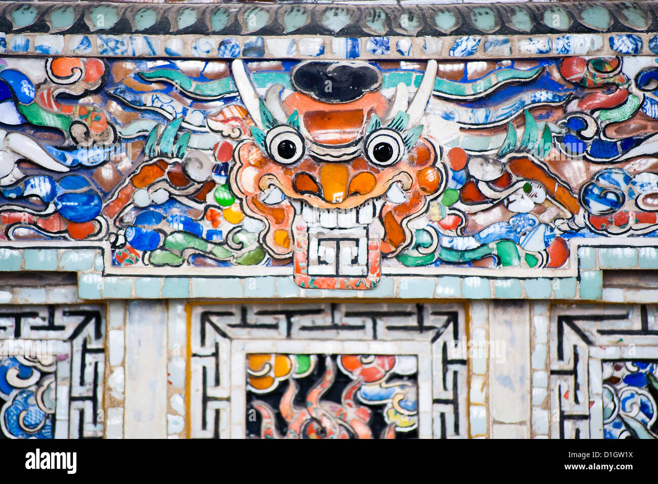 Colourful mosaic detail at The Tomb of Khai Dinh, Hue, Vietnam, Indochina, Southeast Asia, Asia - Stock Image