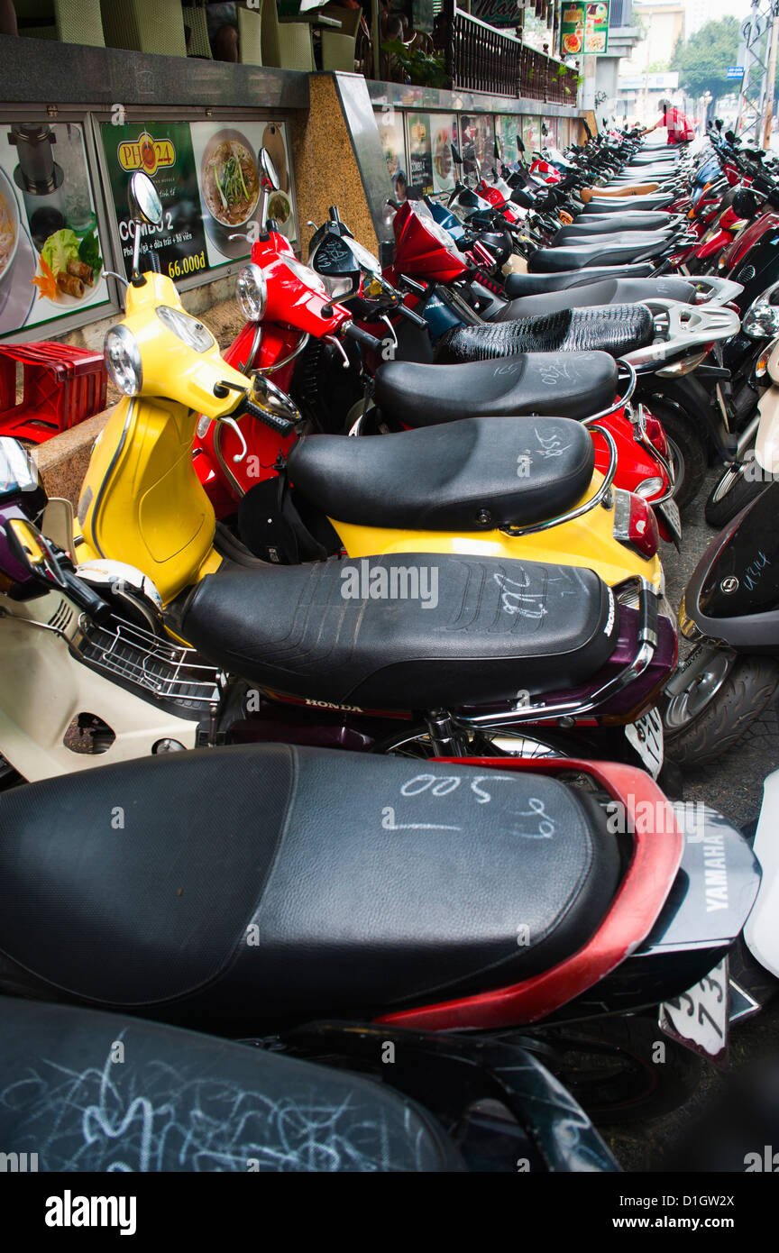 Hundreds of mopeds in a typical street scene in Ho Chi Minh City (Saigon), Vietnam, Indochina, Southeast Asia, Asia Stock Photo