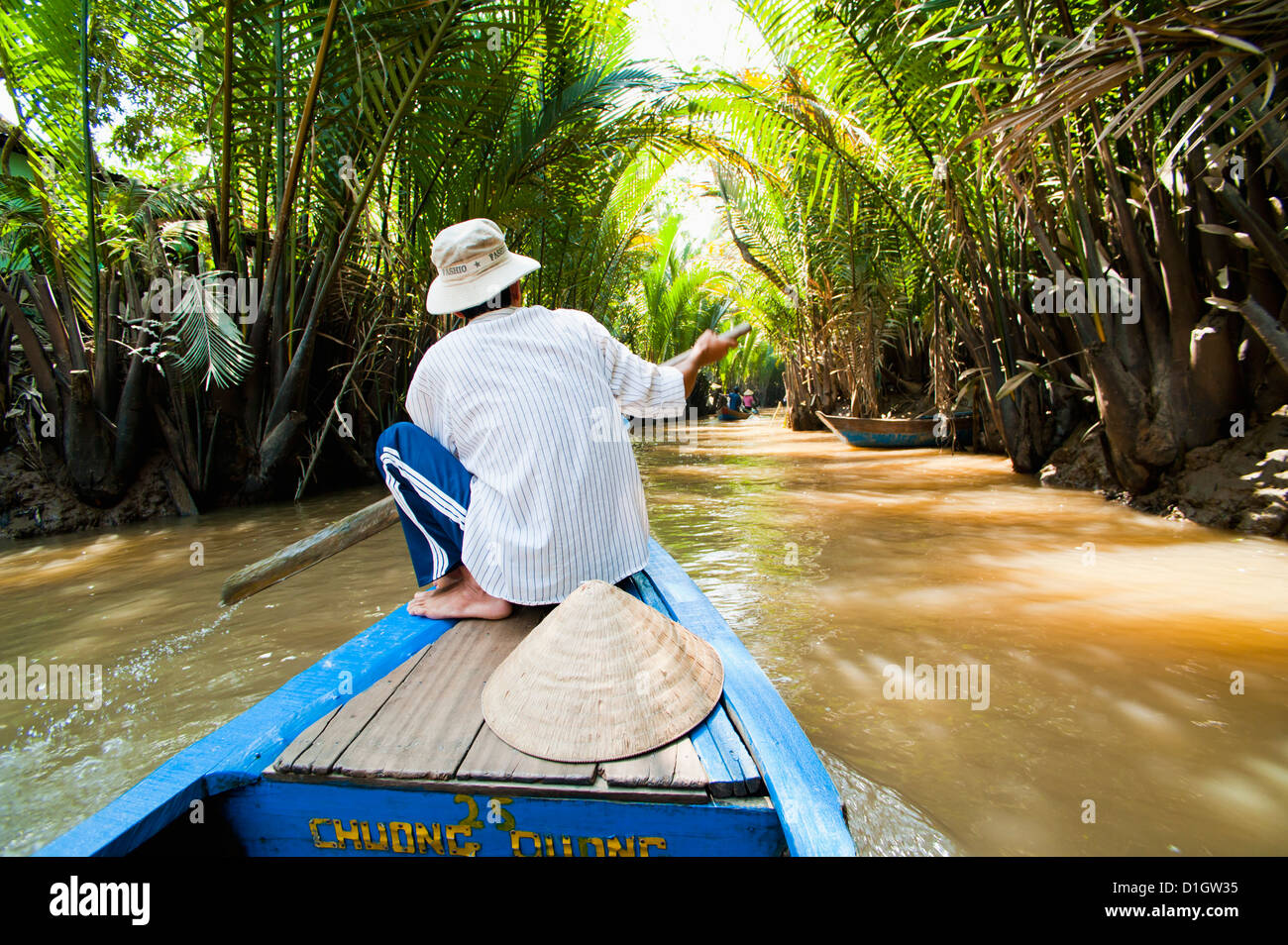 Boat trip up a narrow river in the Mekong Delta, Vietnam, Indochina, Southeast Asia, Asia - Stock Image