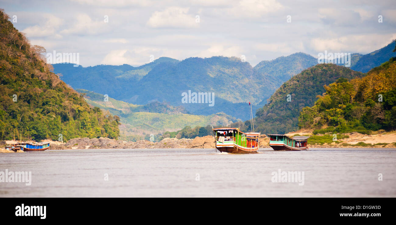 Boats about to dock in Pak Beng, the half-way point on the slow boat from Thailand to Vientiane, Mekong River, Laos, - Stock Image