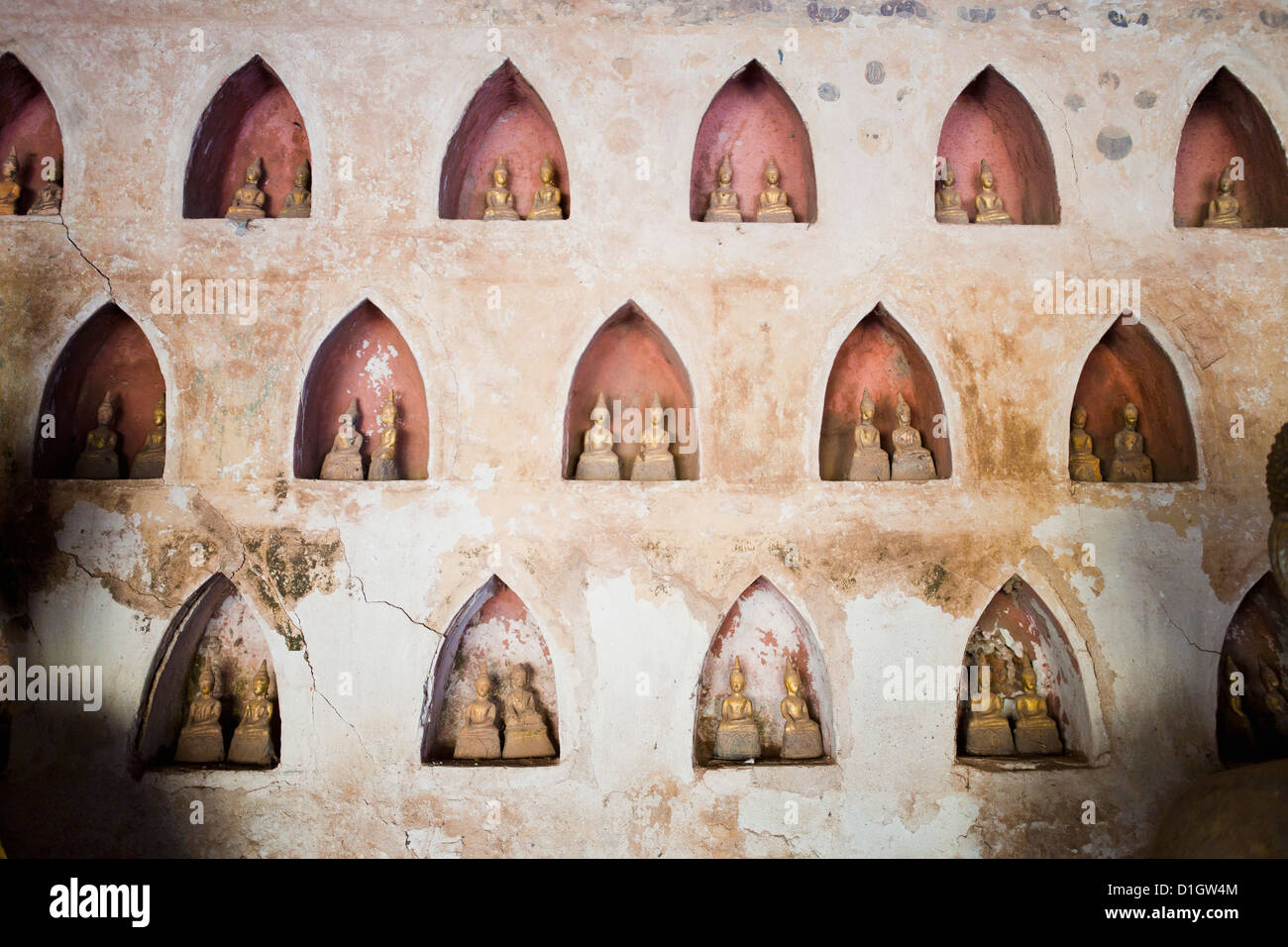 Pairs of small Buddha statues at Wat Si Saket, the most famous temple in Vientiane, Laos, Indochina, Southeast Asia, - Stock Image