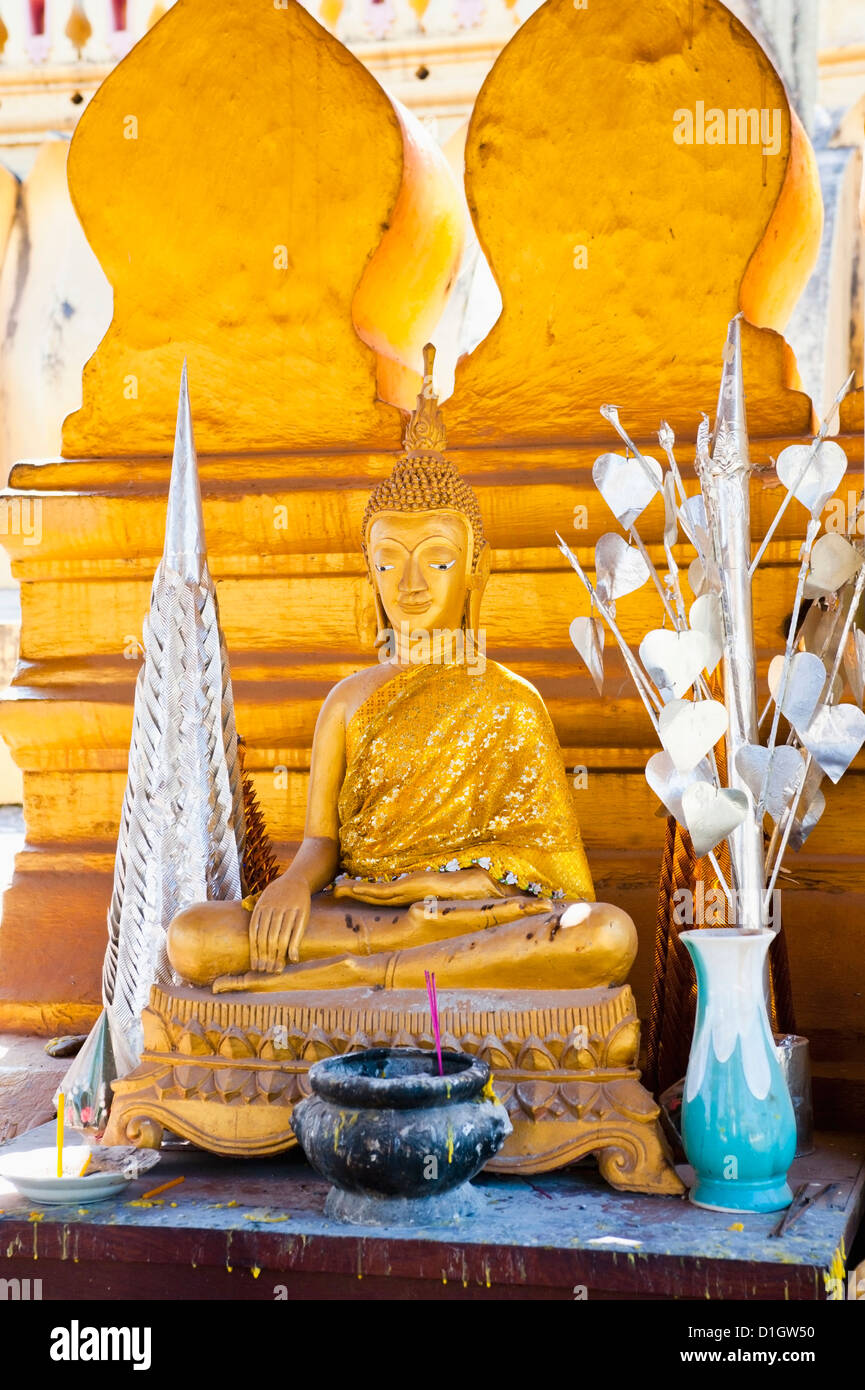 Bright gold Buddha statue at Pha That Luang, a Buddhist templ, Vientiane, Laos, Indochina, Southeast Asia, Asia - Stock Image