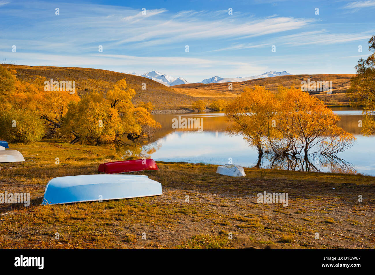 Rowing boats and snow capped mountains at Lake Alexandrina, Southern Lakes, Otago Region, South Island, New Zealand, - Stock Image