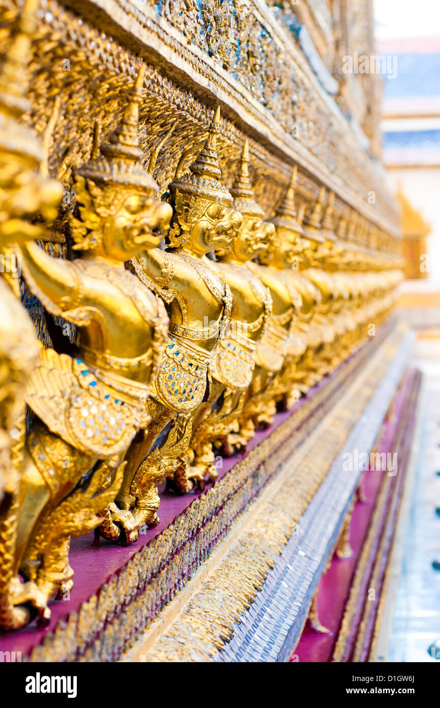 Guardian statues at Temple of the Emerald Buddha (Wat Phra Kaew), The Grand Palace, Bangkok, Thailand, Southeast - Stock Image