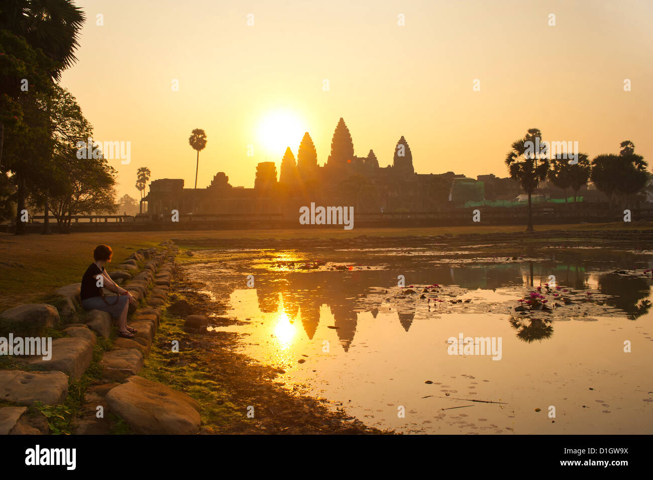 Tourist watching sunrise at Angkor Wat Temple, Angkor Temples, Siem Reap Province, Cambodia, Indochina, Southeast - Stock Image