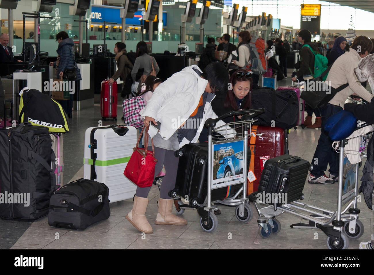December 21 2012.  T5 Heathrow Airport, London. Passengers wait in line in the departure area on what was expected - Stock Image