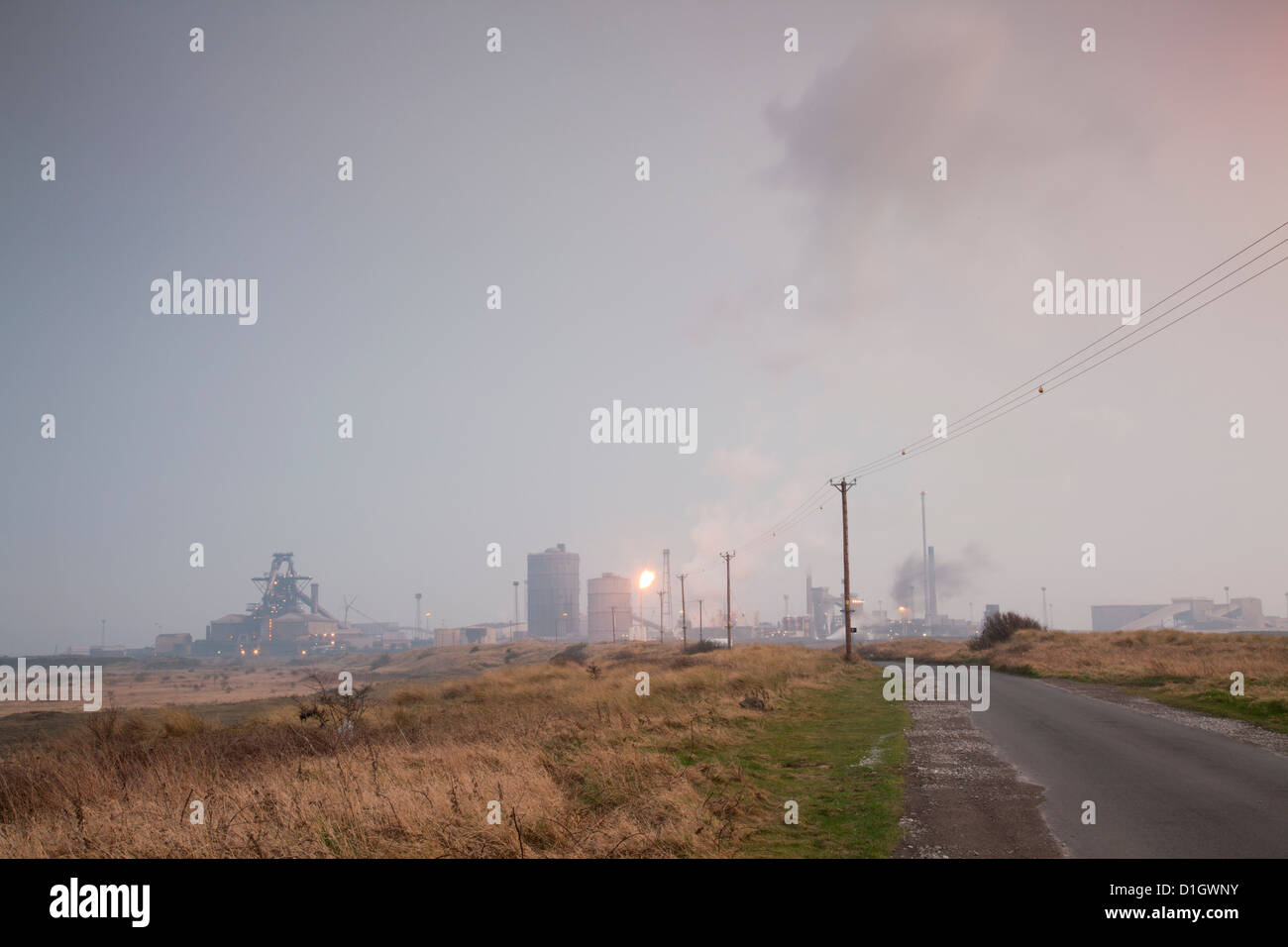 Redcar steelworks at sundown, viewed from the South Gare. - Stock Image