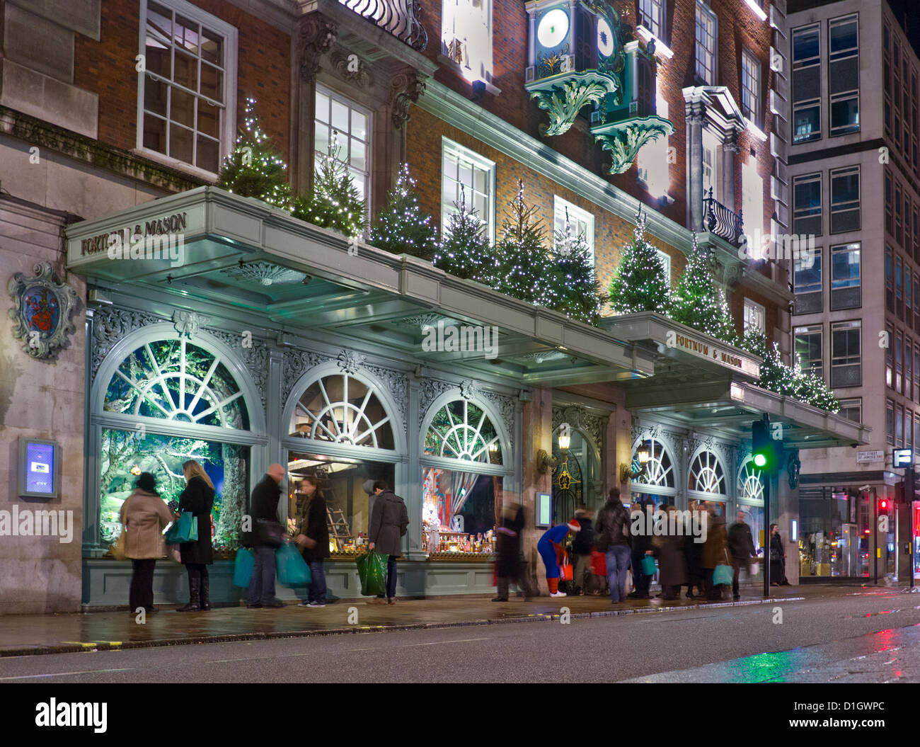 Fortnum mason department store at night busy with - Fortnum and mason christmas decorations ...