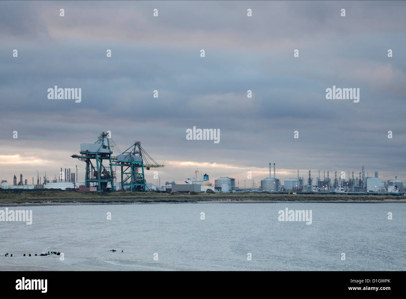 Teesside heavy industry seen from the South Gare of the River Tees at sunset. - Stock Image