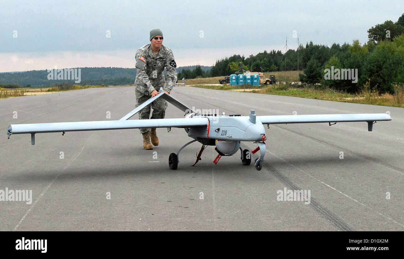 An Army unmanned aerial vehicle operator pushes a Shadow UAV
